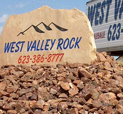 West Valley Rock sign on top of stones.